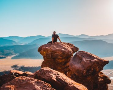 Man on rock jamie-fenn-239405-unsplash