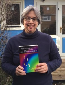 Outside my writing shed with the book I wrote in 2012